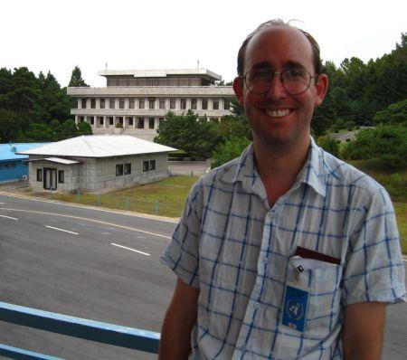 Adam in the Joint Security Area, Korea, with North Korea behind him
